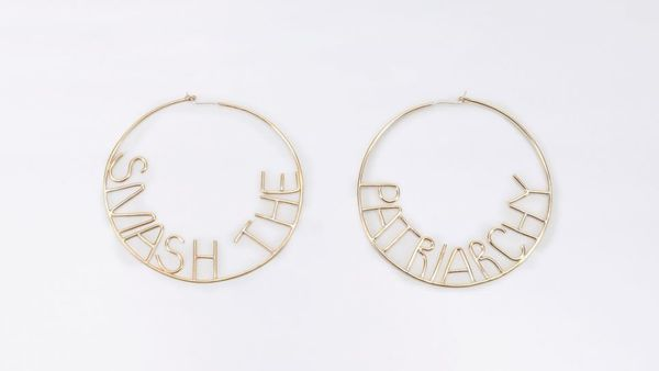 "Get them <a href=""https://www.wildfang.com/smash-the-patriarchy-hoop-earrings119996.html"" target=""_blank"">here</a>.&nbsp;"