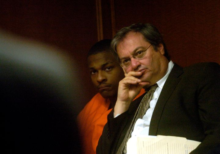 Robert Ray, center, listens after being indicted for double homicide at Arapahoe County Court on Monday March. 13, 2006.