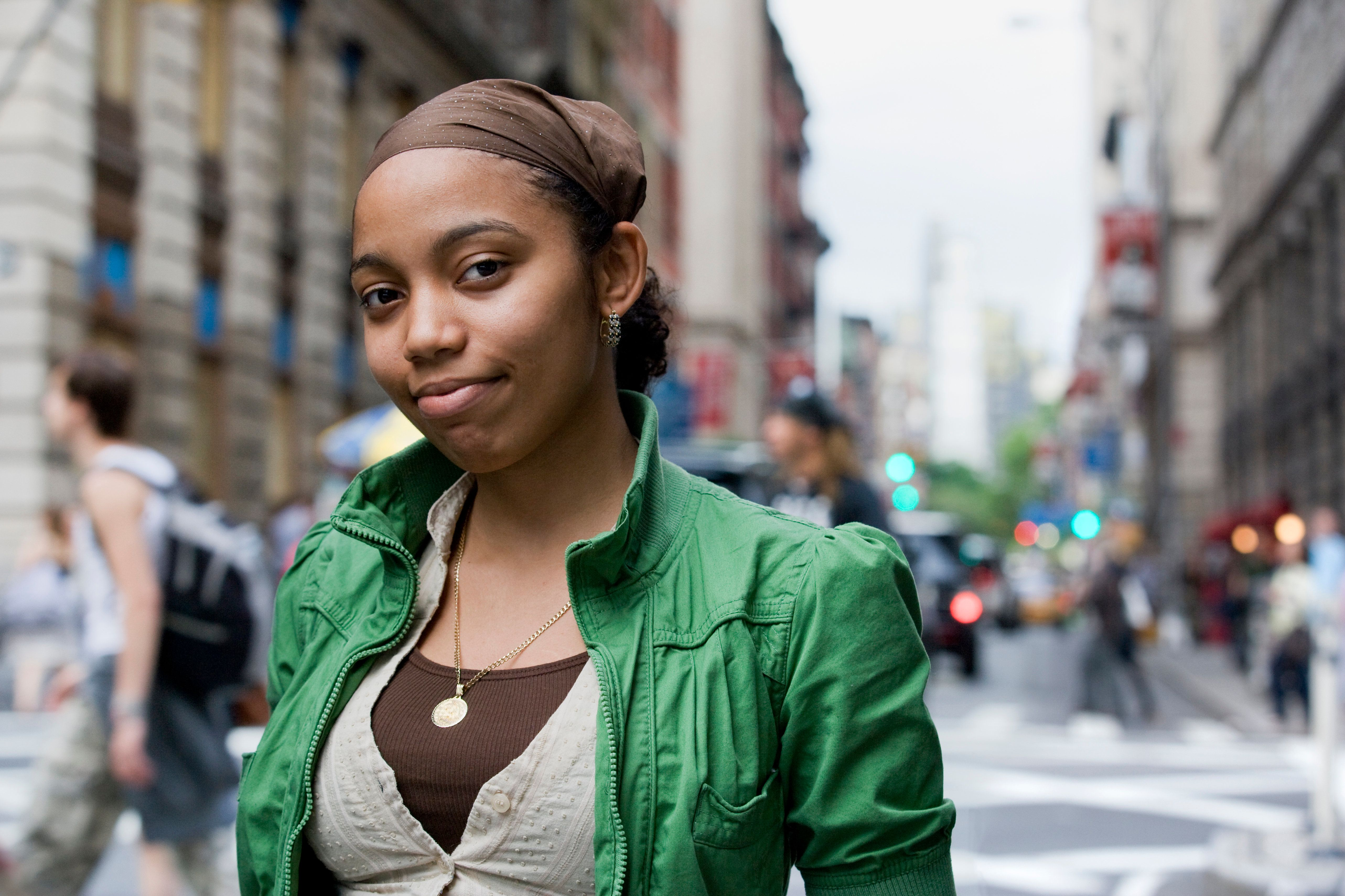 Portrait of young Hispanic woman in downtown city, New York City