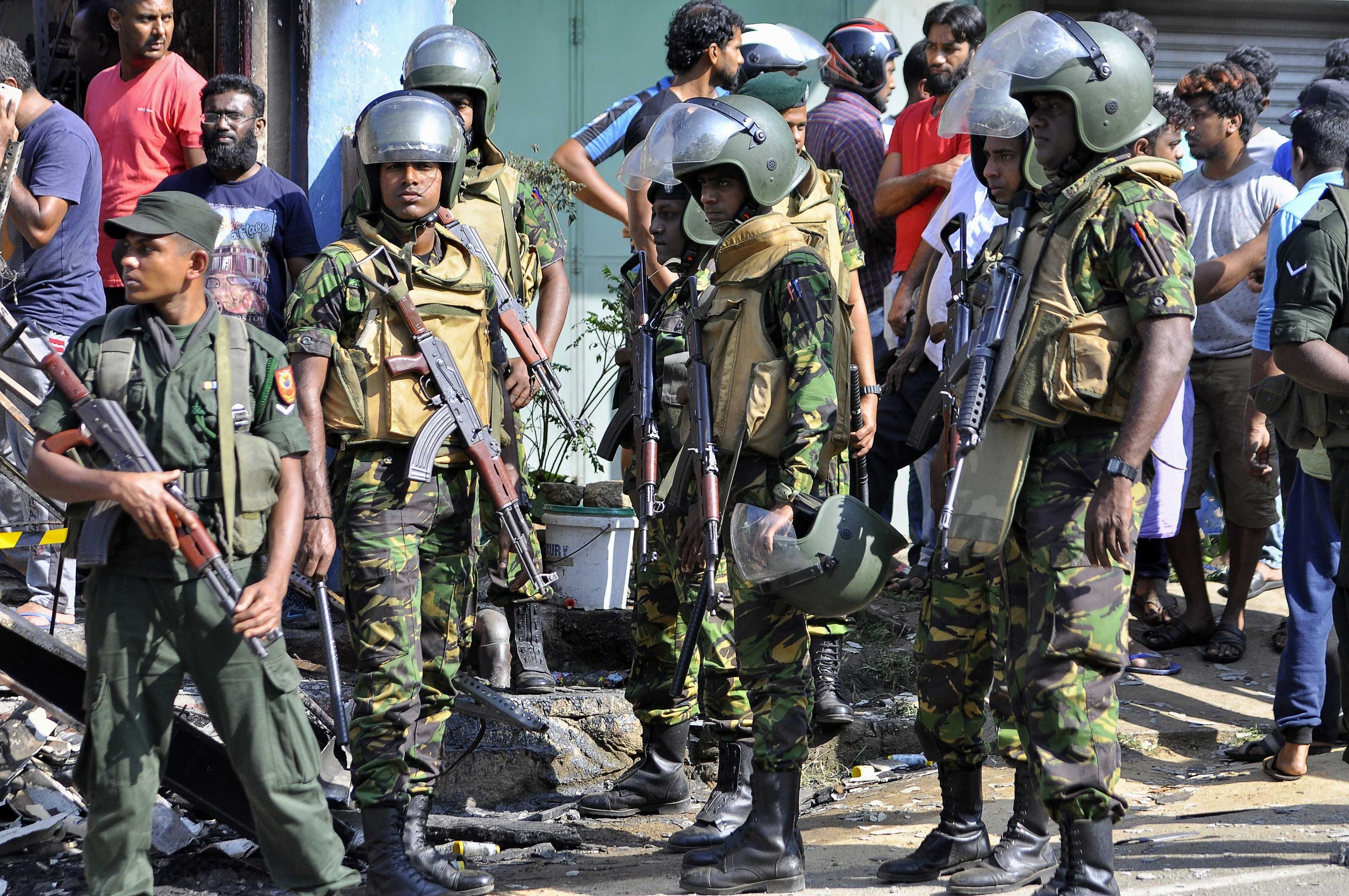 Sri Lankan police commandos patrol on the streets of Pallekele, a suburb of Kandy, on March 6, 2018, following anti-Muslim riots that has prompted the government to declare a state of emergency. Sri Lanka on March 6 declared a nationwide state of emergency to quell anti-Muslim riots that have killed at least two people and damaged dozens of mosques and homes. The curfew in the district was extended after the body of a Muslim man was pulled from the ashes of a burnt building, threatening to further raise communal tensions that have flared up across Sri Lanka in recent weeks.  / AFP PHOTO / -        (Photo credit should read -/AFP/Getty Images)