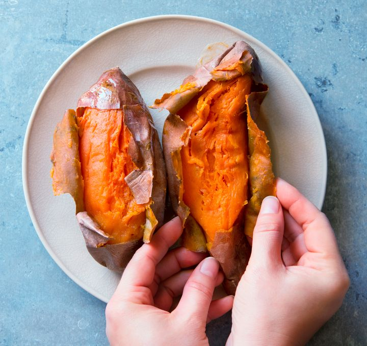 A baked sweet potato can be the base for a snack.