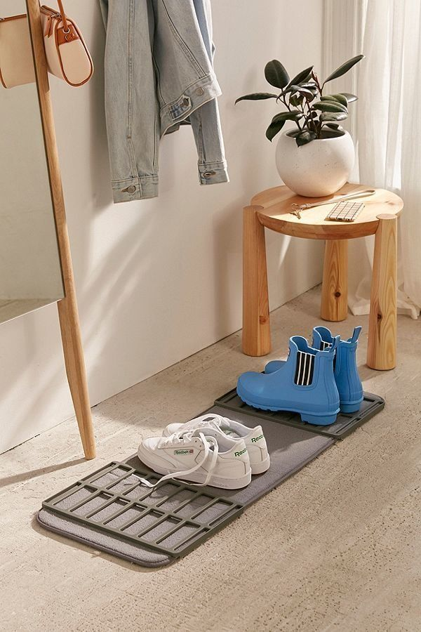 """Get it <a href=""""https://www.urbanoutfitters.com/shop/shoe-drying-mat?category=bathroom-accessories&color=004"""" target=""""_bl"""