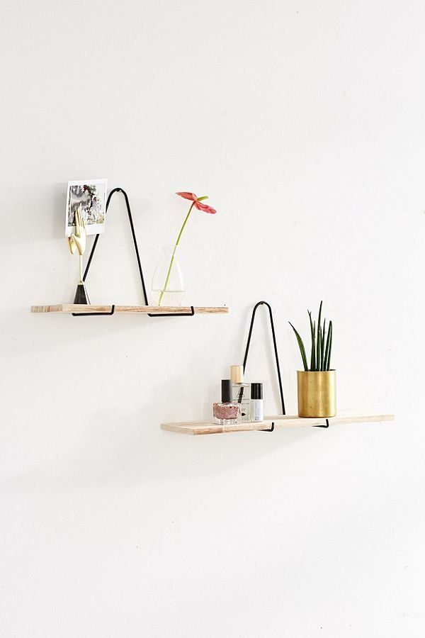 "Get it <a href=""https://www.urbanoutfitters.com/shop/carter-triangle-bracket-wall-shelf?category=shelving&color=001"" targ"
