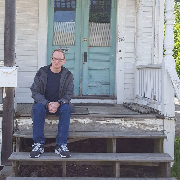 Michael Broussard in 2017 on the porch of the house on High Street in Clinton, Massachusetts, where he lived while being