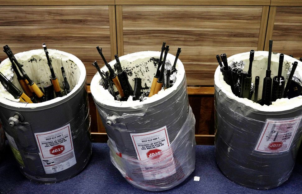 Weapons smuggled in hollowed-out pool water heaters are seized at Rio de Janeiro's international airport on June 1,