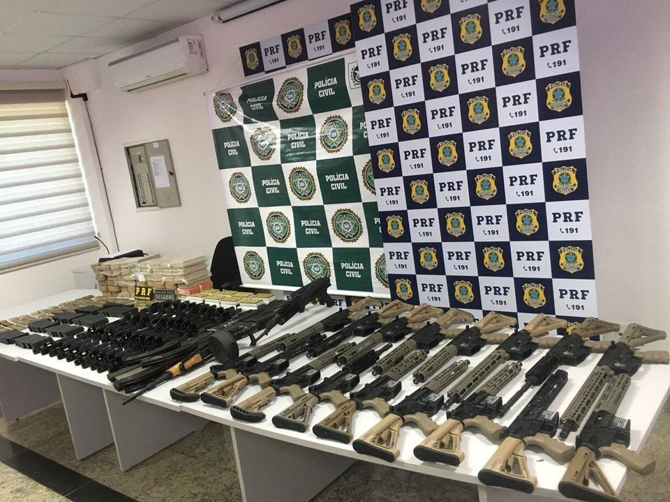 Rifles seized last month in Brazil. On the side of the rifles is an image of the U.S.
