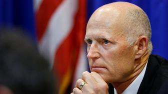 Florida Governor Rick Scott listens during a meeting with law enforcement, mental health, and education officials about how to prevent future tragedies in the wake of last week's mass shooting at Marjory Stoneman Douglas High School, at the Capitol in Tallahassee, Florida, U.S., February 20, 2018.   REUTERS/Colin Hackley