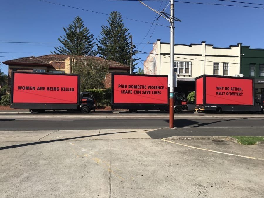 The mobile billboards outside the office of Australia's minister for women.