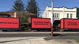 Three billboards outside the office of Australias Minister for Women asking for domestic violence leave
