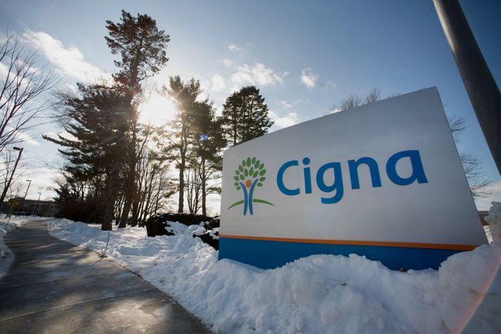 Snow covers the ground around Cigna Corp. signage displayed at the company's headquarters in Bloomfield, Connecticut, U.S., o