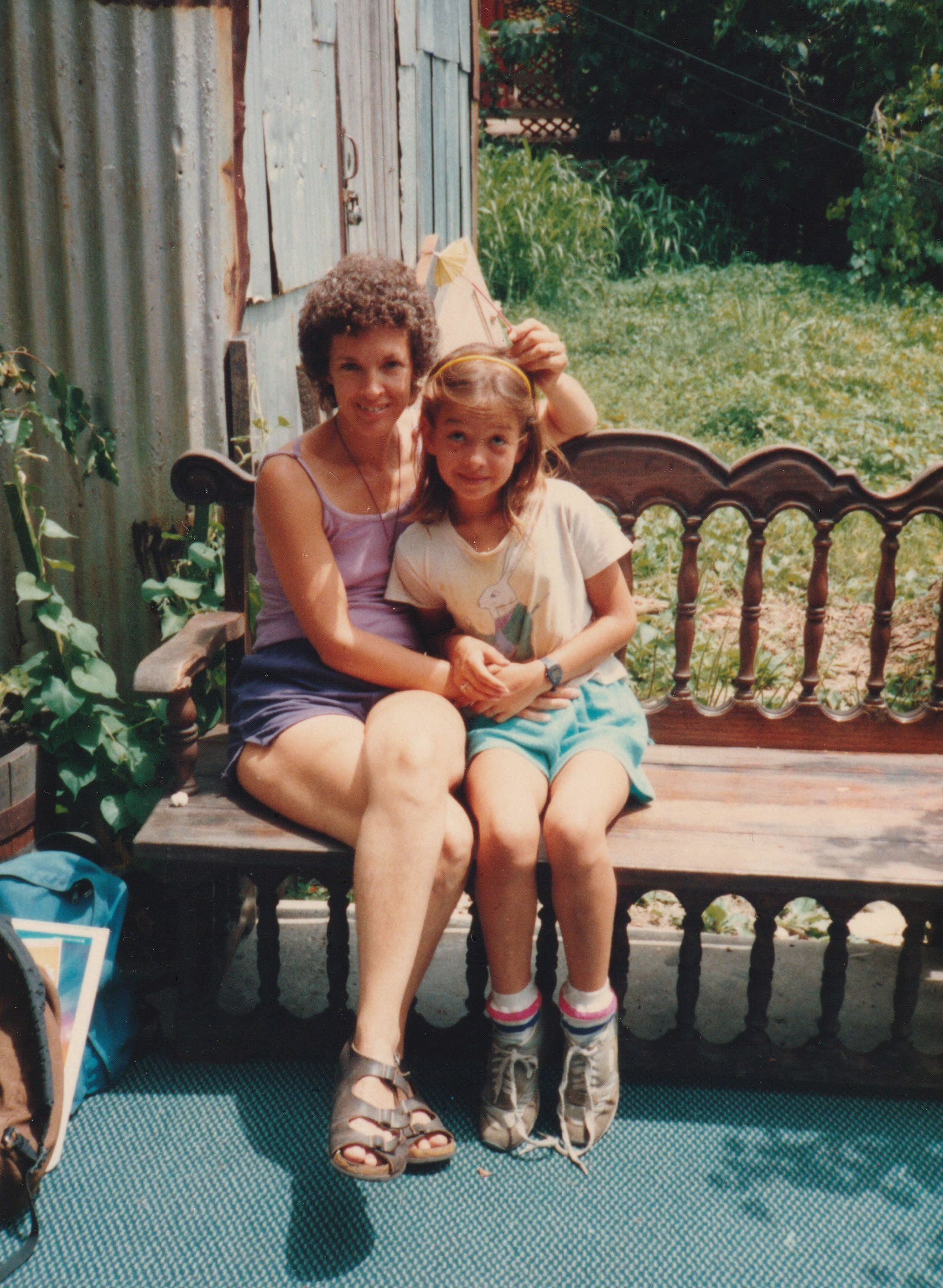 The author, just home from Girl Scouts camp, with her mother in the summer of 1987.