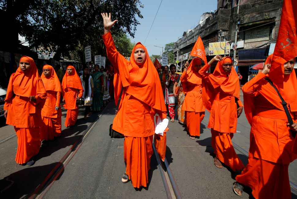 Hindu nuns shout slogans during a rally to mark International Women's Day.