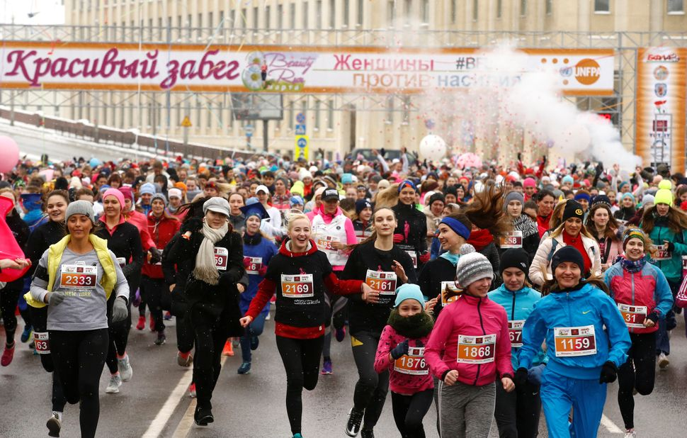 "Women participate in the ""Beauty Run"" to mark International Women's Day."