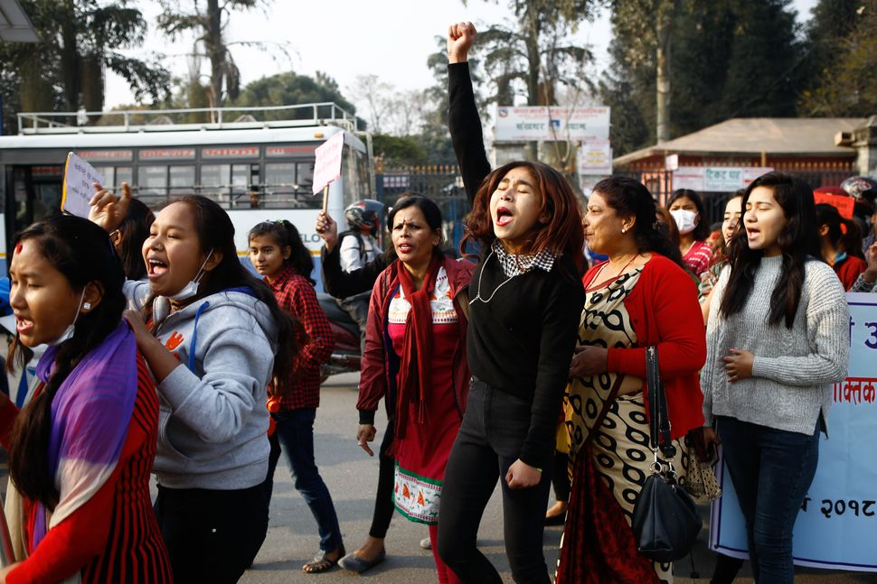 Nepalese women take part in a rally to mark International Women's Day.