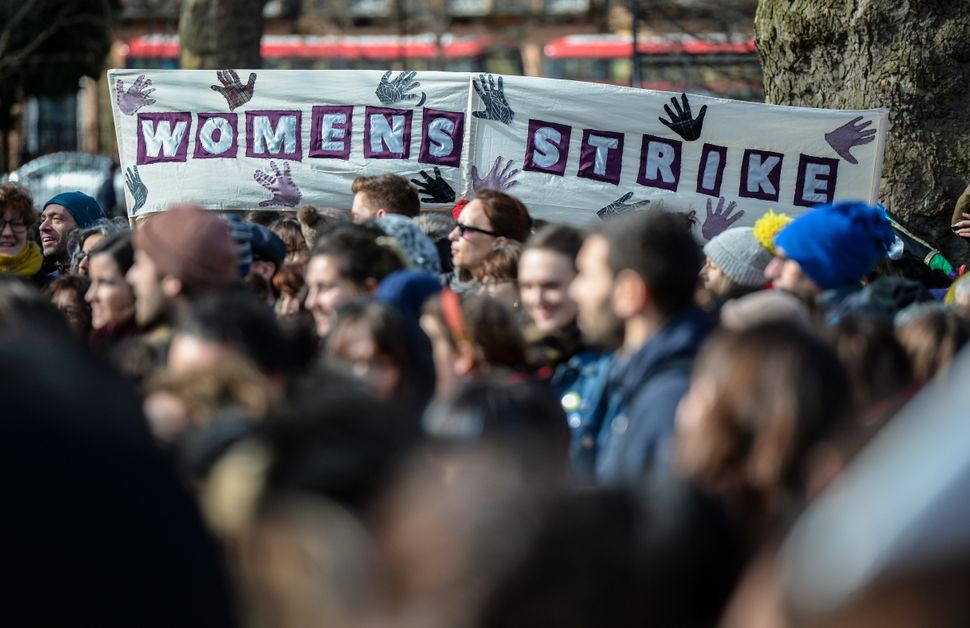 Women's rights demonstrators hold placards during a rally in Russell Square.