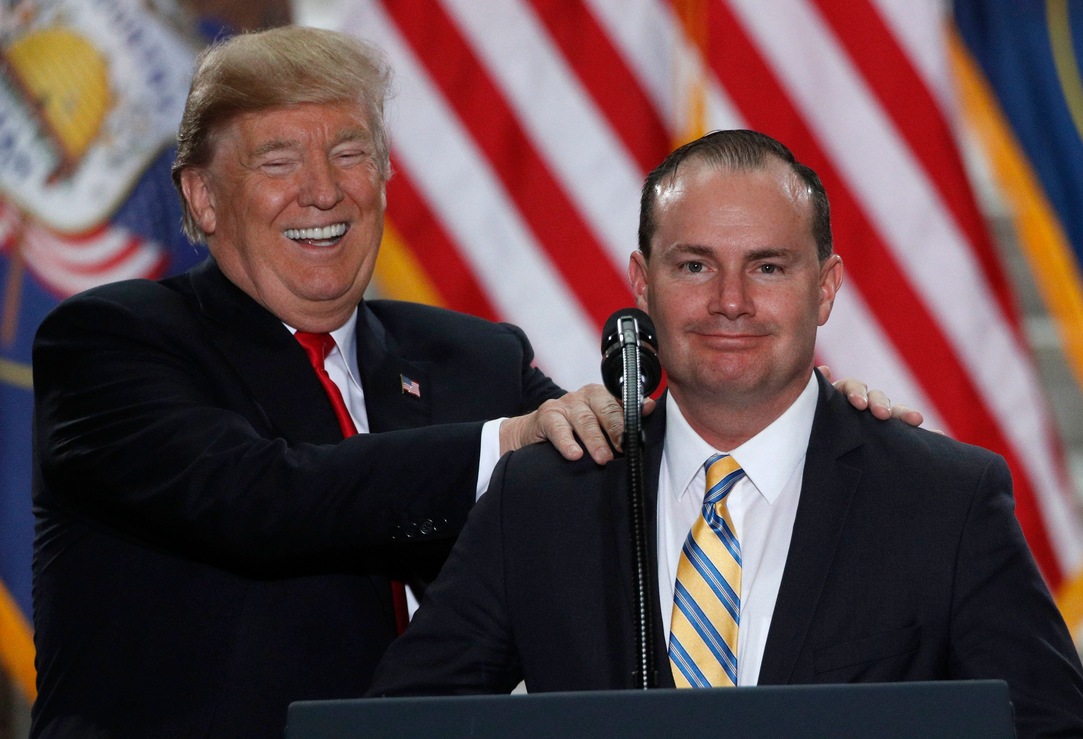 SALT LAKE CITY, UT - DECEMBER 4: U.S. President Donald Trump jokes with Senator Mike Lee (R-UT) as he speaks at the Rotunda of the Utah State Capitol on December 4, 2017 in Salt Lake City, Utah. Trump announced the reduction in size of the Bears Ears and Grand Staircase-Escalante National Monuments which were created by Presidents Obama and Clinton.  (Photo by George Frey/Getty Images)