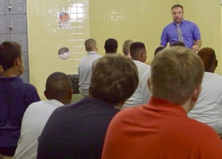 Coaching Boys Into Men curriculum being taught to the football team at an Iowa middle school.