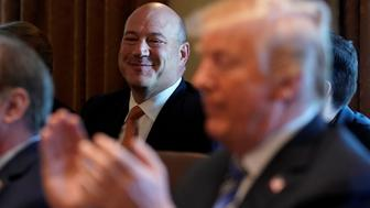 U.S. President Donald Trump applauds his outgoing economic adviser Gary Cohn (L) during a cabinet meeting at the White House in  Washington, U.S., March 8, 2018. REUTERS/Kevin Lamarque