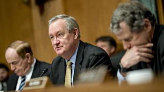 Senator Mike Crapo, a Republican from Idaho and chairman of the Senate Banking, Housing and Urban Development Committee, center, makes an opening statement during a hearing in Washington, D.C., U.S., on Tuesday, Feb. 6, 2018. Cryptocurrency exchanges roiled by the rout in Bitcoin prices may face more turbulence as the two top U.S. market regulators ask Congress to consider federal oversight for the trading platforms. Photographer: Andrew Harrer/Bloomberg via Getty Images