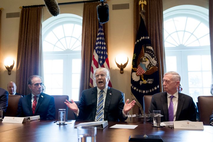 Trump is seen during Thursday's cabinet meeting, while flanked by U.S. Secretary of Defense Jim Mattis, to the right, an