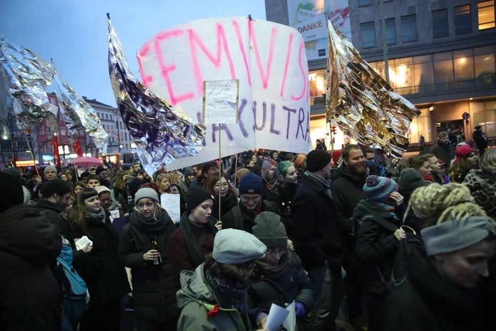 Demonstrators march for women's rights near Hermannplatz square.