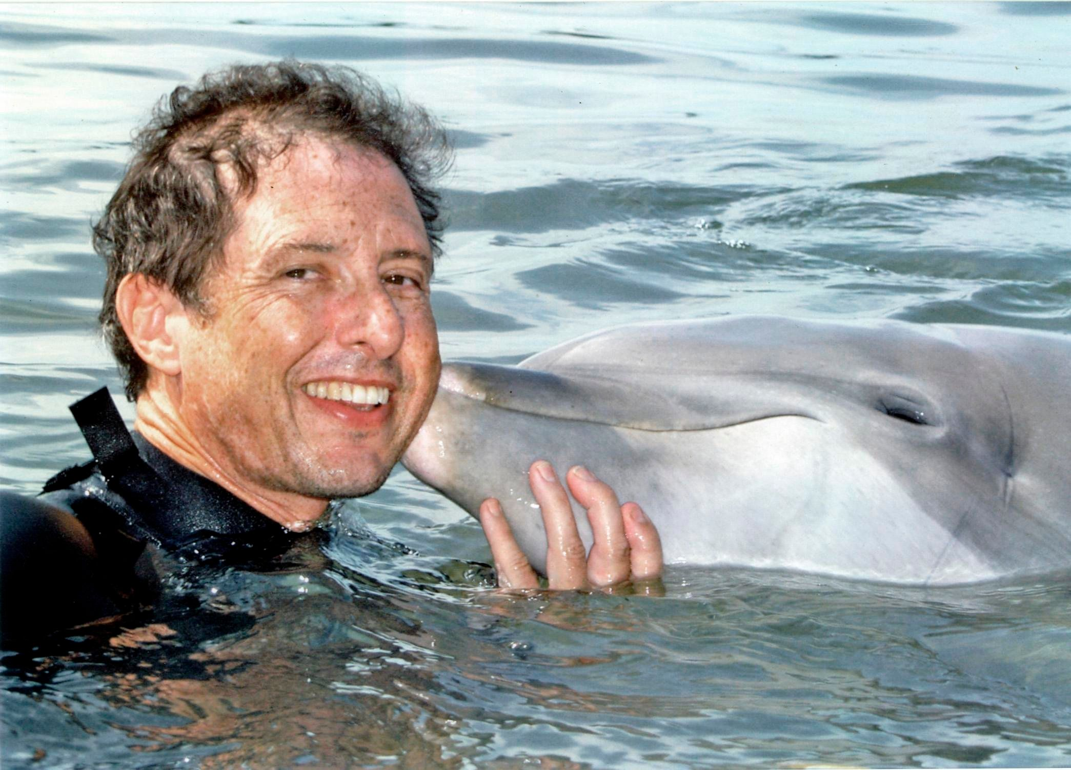 Malcolm Brenner with an unidentified dolphin.