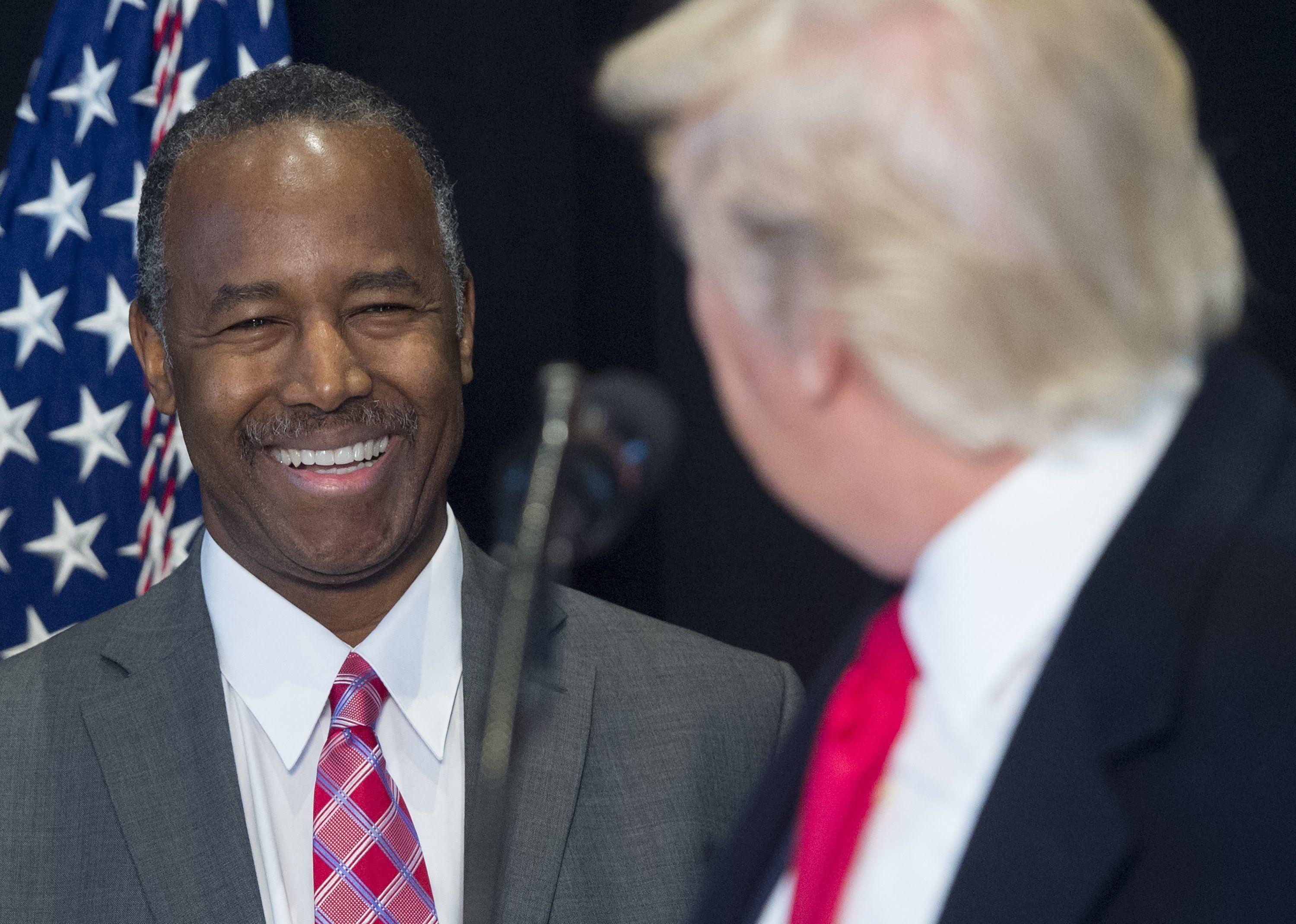 US President Donald Trump speaks alongside Dr. Ben Carson (L), his nominee for Secretary of Housing and Urban Development, following a tour of the Smithsonian National Museum of African American History and Culture in Washington, DC, February 21, 2017. / AFP / SAUL LOEB        (Photo credit should read SAUL LOEB/AFP/Getty Images)