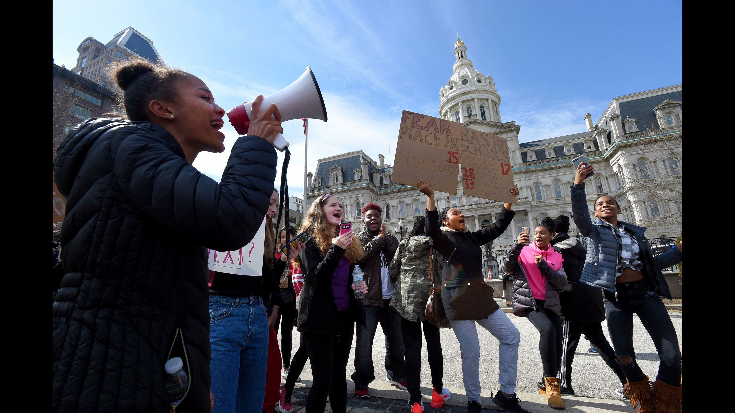Baltimore students outside City Hall stage a #gunsdowngradesup school walkout on Tuesday, March 6, 2018 to protest gun violence in schools and the city. (Lloyd Fox/Baltimore Sun/TNS via Getty Images)