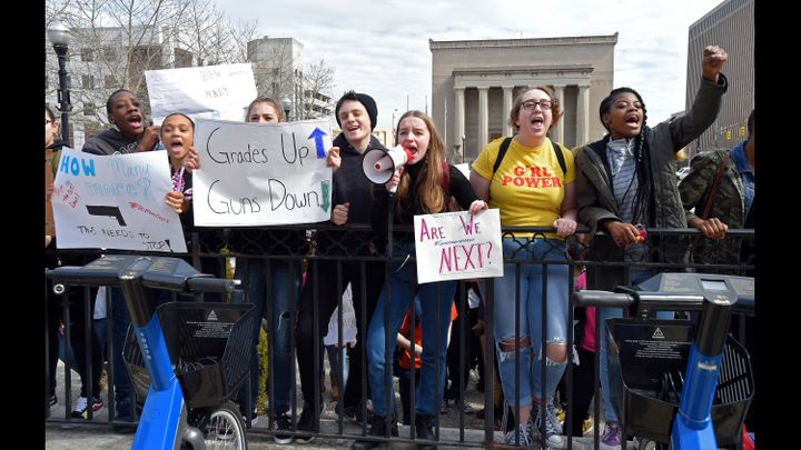 Baltimore students, seen outside of City Hall on Tuesday, participated in a walkout to protest gun violence in schools a