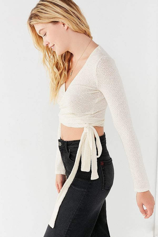 """Get it <a href=""""https://www.urbanoutfitters.com/shop/uo-cozy-long-sleeve-cropped-wrap-top"""" target=""""_blank"""">here</a>."""