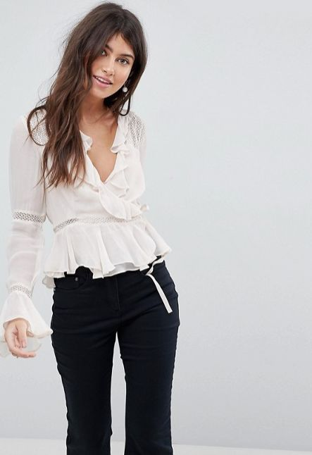 """Get it <a href=""""http://us.asos.com/asos/asos-wrap-top-with-ruffle-and-lace-insert/prd/8669895?clr=cream&SearchQuery=wrap%"""