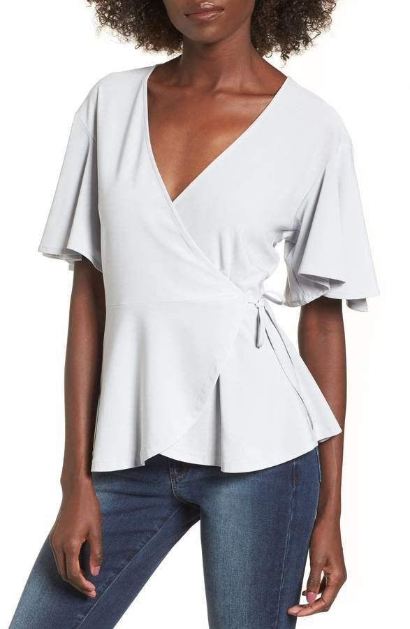 """Get it <a href=""""https://shop.nordstrom.com/s/leith-flounce-sleeve-faux-wrap-top/4740030?origin=category-personalizedsort&"""