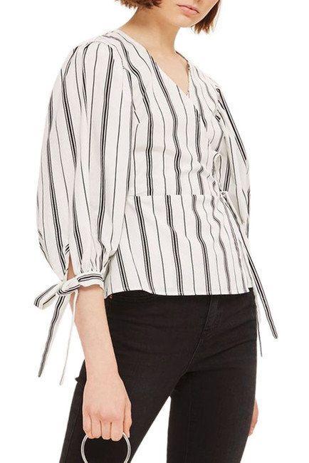 "Get it <a href=""https://www.nordstromrack.com/shop/product/2273515/topshop-balloon-sleeve-stripe-wrap-top?color=WHITE%20MULTI"