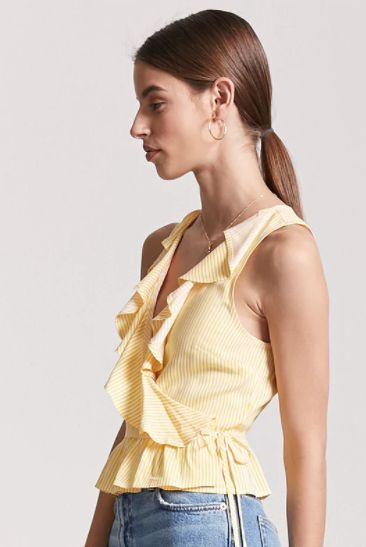 """Get it <a href=""""https://www.forever21.com/us/shop/catalog/Product/F21/top_blouses/2000253672"""" target=""""_blank"""">here</a>."""