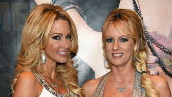 LAS VEGAS, NV - JANUARY 22:  Adult film actresses/directors jessica drake (L) and Stormy Daniels pose at the Wicked Pictures booth at the 2015 AVN Adult Entertainment Expo at the Hard Rock Hotel & Casino on January 22, 2015 in Las Vegas, Nevada.  (Photo by Ethan Miller/Getty Images)