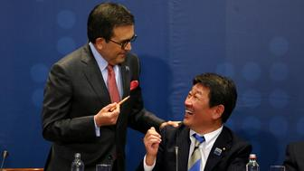 Mexico's Secretary of Economy Ildefonso Guajardo Villarreal talks to Japan's Minister of Economic Revitalization Toshimitsu Motegi, during the signing agreement ceremony for the Trans-Pacific Partnership (TPP) trade deal, in Santiago, Chile March 8, 2018. REUTERS/Ivan Alvarado