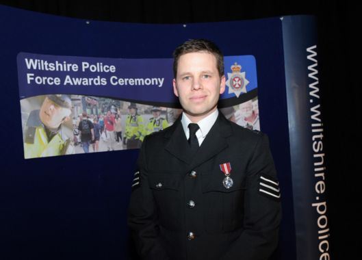 Detective Sergeant Nick Bailey who is sitting up and talking at Salisbury District