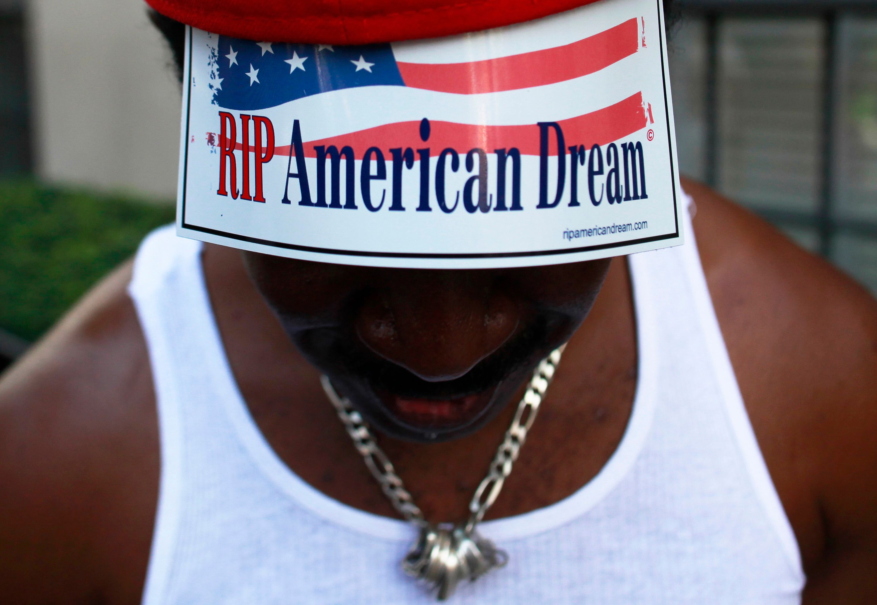 A member of Occupy Wall Street protesting on 5th Avenue in October 2011. A new report has found racial...