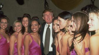 (Original Caption) Donald Trump with Miss USA delegates. He is sponsor of Miss Universe, Miss USA & Miss Teen pageants (Photo by Steve Azzara/Corbis via Getty Images)