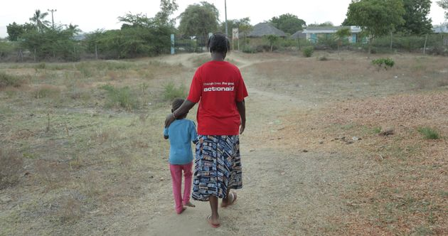 A rape survivor with an ActionAid worker