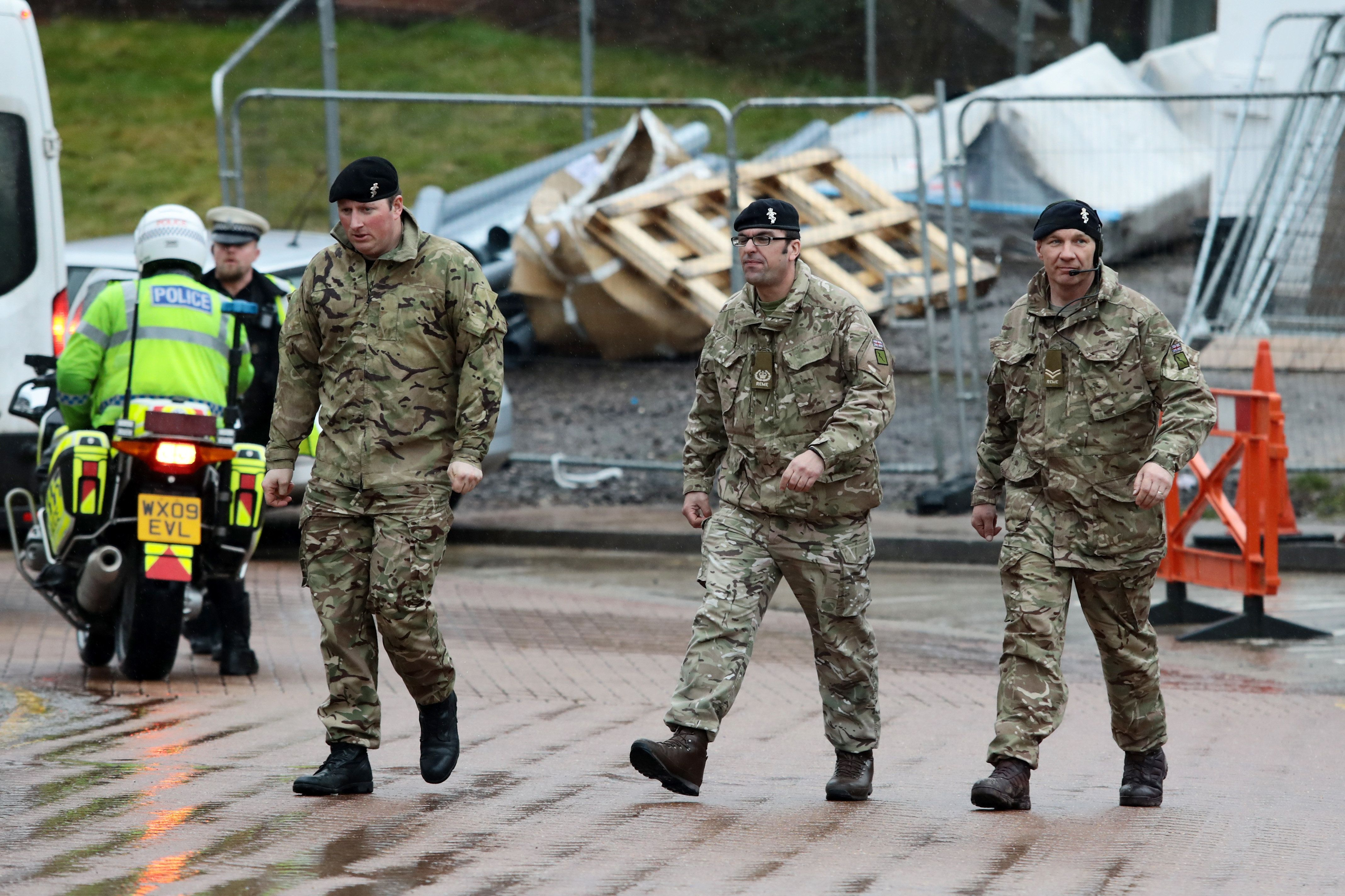 Military personnel are seen outside Salisbury District Hospital where around 180 troops have been deployed