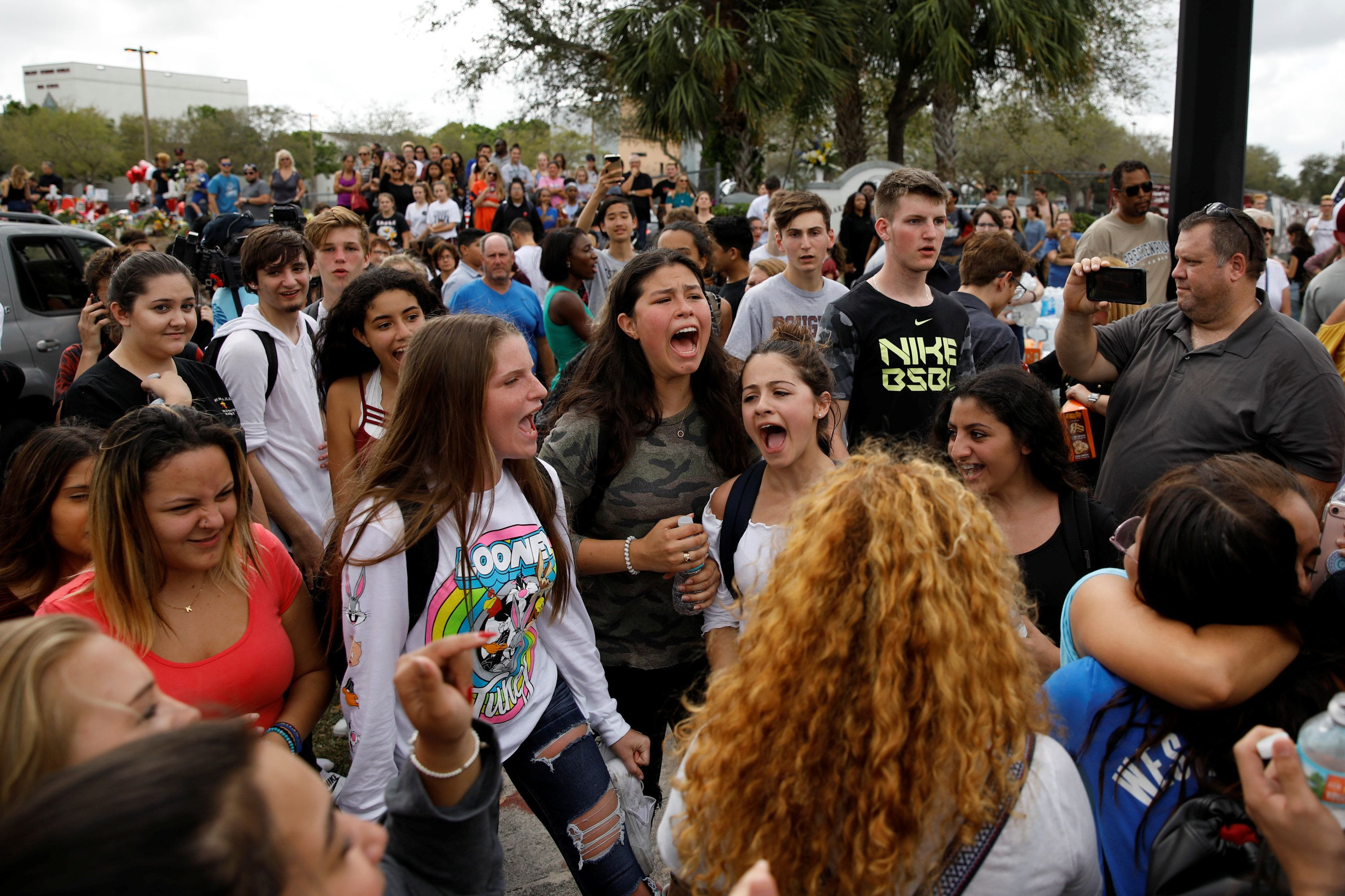 Students shout slogans during a protest to show support for Marjory Stoneman Douglas High School, following a mass shooting in Parkland, Florida, U.S., February 20, 2018. REUTERS/Carlos Garcia Rawlins