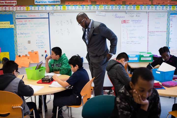 Antwan Wilson visits a fifth-grade math class at the Brightwood Education Campus in Washington, D.C. on Feb. 1, 201
