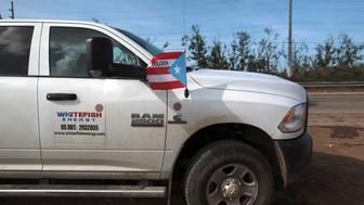 A pick up from Montana-based Whitefish Energy Holdings is parked as workers (not pictured) help fix the island's power grid, damaged during Hurricane Maria in September, in Manati, Puerto Rico October 25, 2017.  REUTERS/Alvin Baez