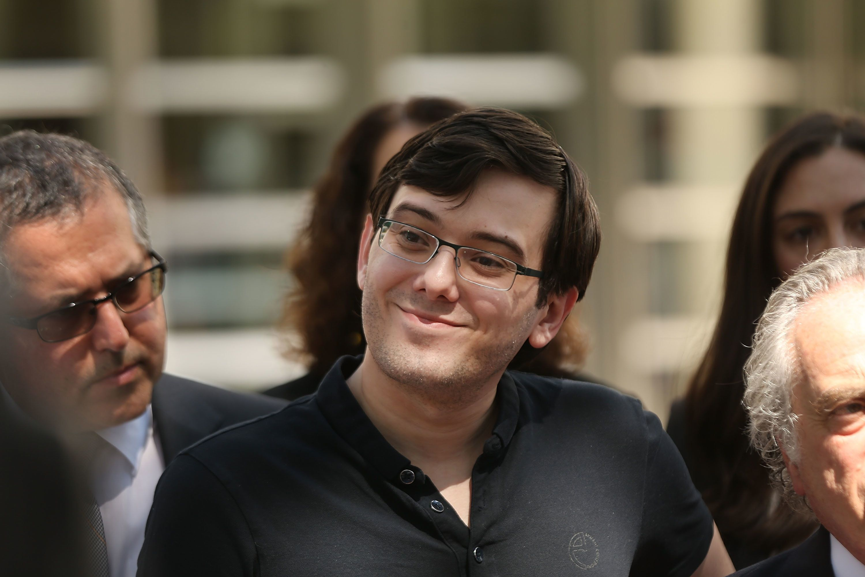 NEW YORK, NY - AUGUST 04:  Former pharmaceutical executive Martin Shkreli smiles while speaking to the media in front of U.S. District Court for the Eastern District of New York with members of his legal team after the jury issued a verdict, August 4, 2017 in the Brooklyn borough of New York City. Shkreli was found guilty on three of the eight counts involving securities fraud and conspiracy to commit securities and wire fraud.  (Photo by Spencer Platt/Getty Images)