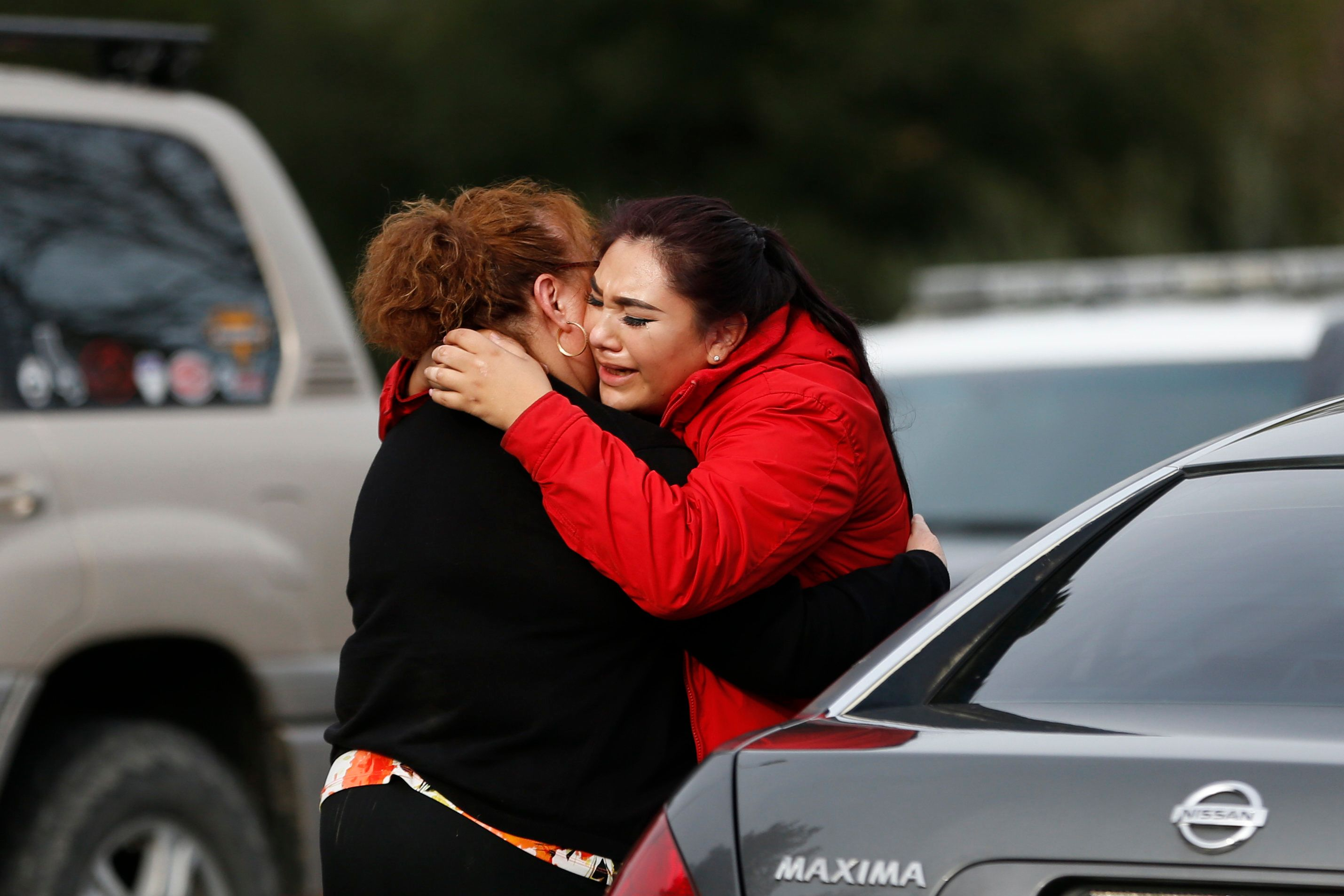 YOUNTVILLE, CA - MARCH 09: Vanessa Flores (R) embraces another woman after she leaves the locked down Veterans Home of California during an active shooter turned hostage situation on March 9, 2018 in Yountville, California. A lone gunman opened fire and is holding three hostages inside the largest veterans facility in the United States founded in 1884. (Photo by Stephen Lam/Getty Images)