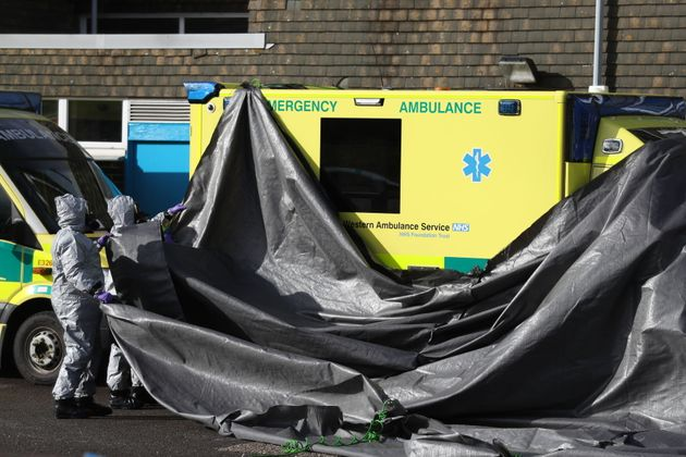 Investigators in gas masks examine an ambulance at the South Western Ambulance Service station in Harnham, near Salisbury.