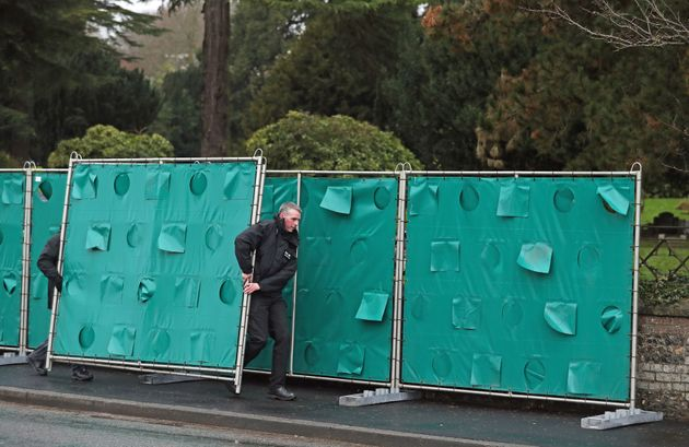Screens are erected outside the London Road cemetery in Salisbury, Wiltshire, as investigations continue at the cemetery where former Russian double agent Sergei Skripal's wife and son were laid to rest.