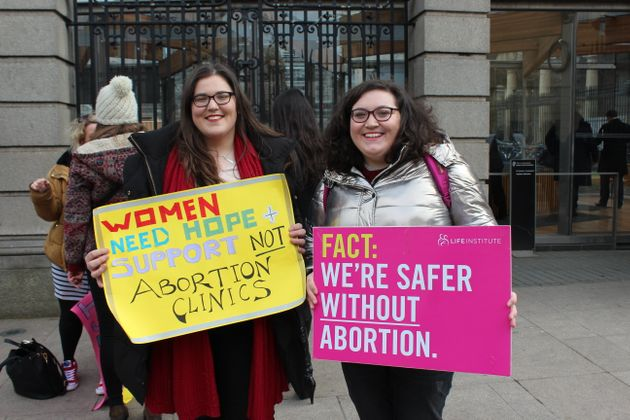 Roisin Ni Fhloinn, left, demonstrates against abortion outside Ireland's lower house of Parliament with...