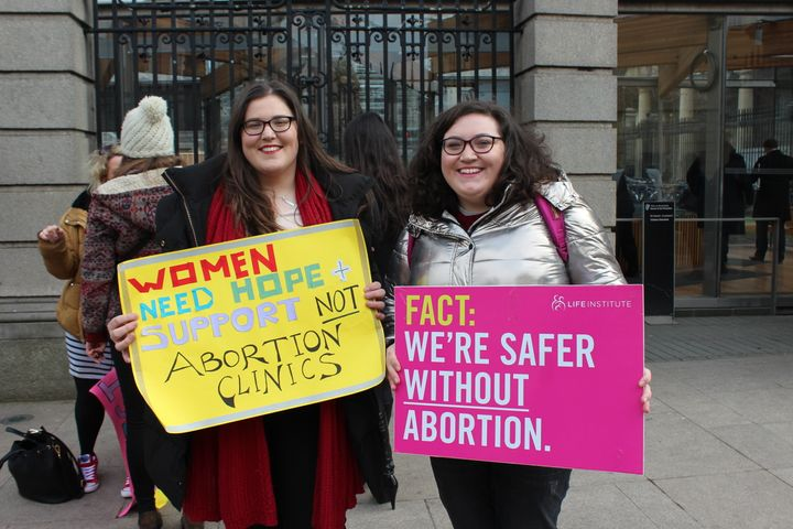 Roisin Ni Fhloinn, left, demonstrates against abortion outside Ireland's lower house of Parliament with her sister.